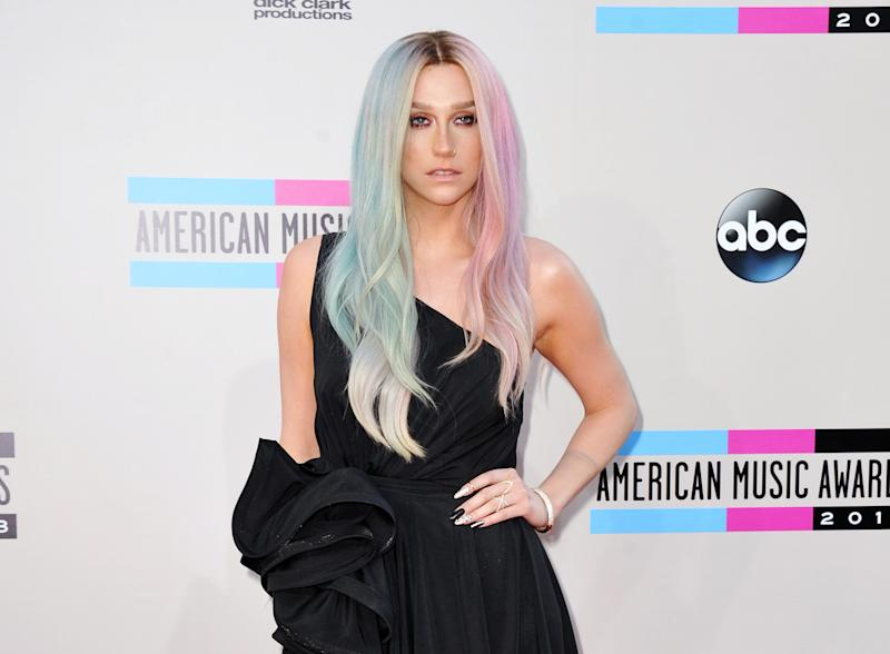 "FILE - This Nov. 24, 2013 file photo shows musician Ke$ha at the American Music Awards at the Nokia Theatre L.A. Live in Los Angeles. Ke$ha's representative confirmed Friday, March 7, 2014, that the singer checked out of rehab. She entered in January. The 26-year-old vegetarian said she entered rehab to ""learn to love myself again, exactly as I am."" Ke$ha, whose real name is Kesha Rose Sebert, is the performer of such tunes as ""Crazy Love,"" ''Die Young"" and ""Timber"" with Pitbull. (Photo by Jordan Strauss/Invision/AP, File)"