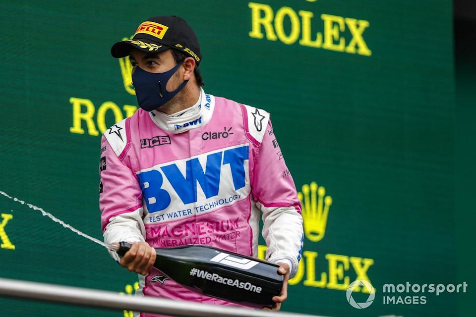 """Sergio Perez, Racing Point, 2nd position, sprays Champagne on the podium<span class=""""copyright"""">Charles Coates / Motorsport Images</span>"""
