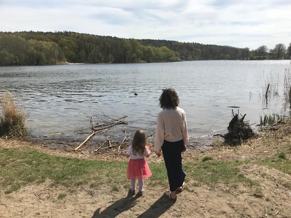 Juliette with her four-year-old daughter on a walk around a lake in West Berlin. The family moved to Germany in January 2020 with the toddler and a 12-week-old baby.Juliette