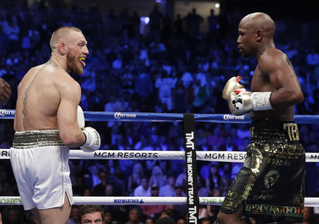 <p>Conor McGregor sticks his tongue out at Floyd Mayweather Jr. in a super welterweight boxing match Saturday, Aug. 26, 2017, in Las Vegas. (AP Photo/Isaac Brekken) </p>