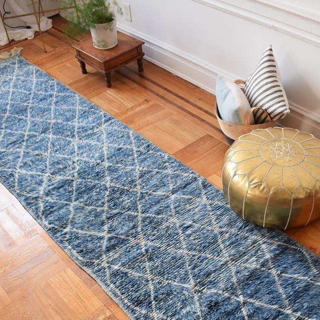 """<p><a class=""""link rapid-noclick-resp"""" href=""""https://shopthemansion.com/collections/rugs/products/blue-runner-rug-27-x-109"""" rel=""""nofollow noopener"""" target=""""_blank"""" data-ylk=""""slk:BUY NOW"""">BUY NOW</a></p><p><strong>Blue Beni Ourain Runner, $1,025, <em>shopthemansion.com</em></strong></p><p><a href=""""https://shopthemansion.com/"""" rel=""""nofollow noopener"""" target=""""_blank"""" data-ylk=""""slk:Collyer's Mansion"""" class=""""link rapid-noclick-resp"""">Collyer's Mansion</a> sells much more than just rugs (that throw pillow selection? Also amazing.) But, its rugs are definitely worth checking out, no matter your price range—they range from affordable to pretty expensive, so there's something for everyone. </p>"""