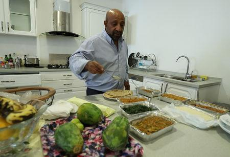 Berhanu Nega, an exiled Ethiopian Ginbot 7 rebel leader prepares lunch in his apartment after a Reuters interview in Addis Ababa, Ethiopia October 19, 2018. Picture taken October 19, 2018. REUTERS/Tiksa Negeri