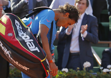 Rafael Nadal of Spain leaves the court after being defeated by Novak Djokovic Wednesday in Paris. (REUTERS/Vincent Kessler)