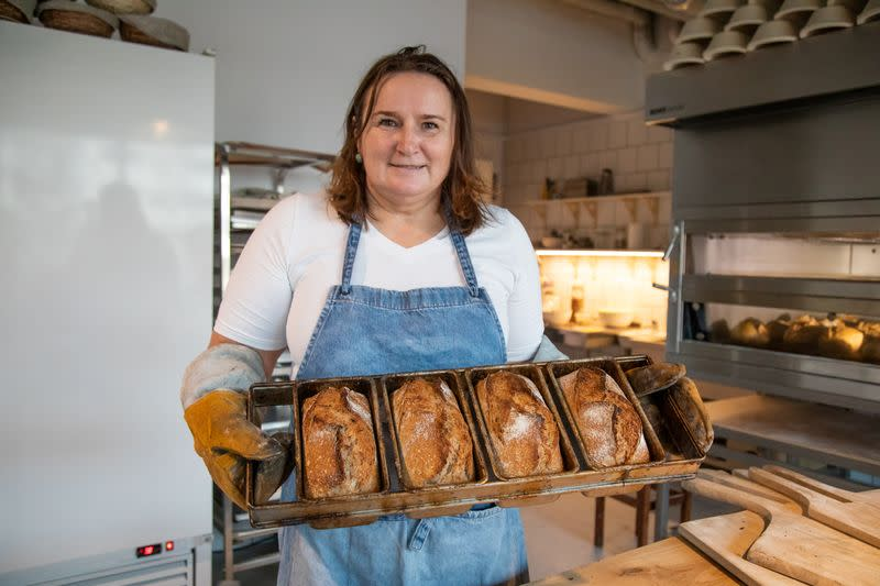 A baker Asia Olejniczak offers breads with a bolt sign as a ubiquitous symbol of the protests sweeping across Poland, in Warsaw