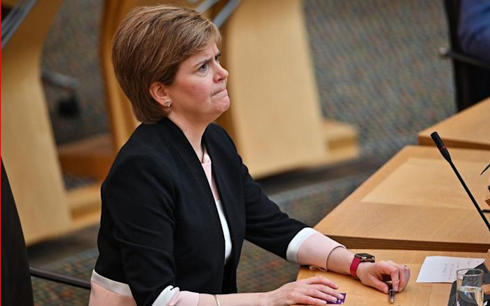 Nicola Sturgeon during First Minister's Questions at the Scottish Parliament in Holyrood - Jeff J Mitchell /PA