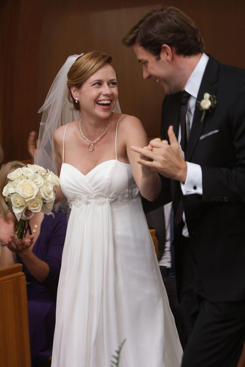 <p>Jim and Pam were the couple you were rooting for on <em>The Office. </em>Their flirty co-worker relationship moved into dating territory, resulting in a romantic but unplanned gas station proposal, and culminating in the couple's Niagara Falls wedding in season 6. Pam wore this spaghetti-strap dress with a sweetheart neckline, a rhinestone necklace, and a short veil for the occasion.</p>