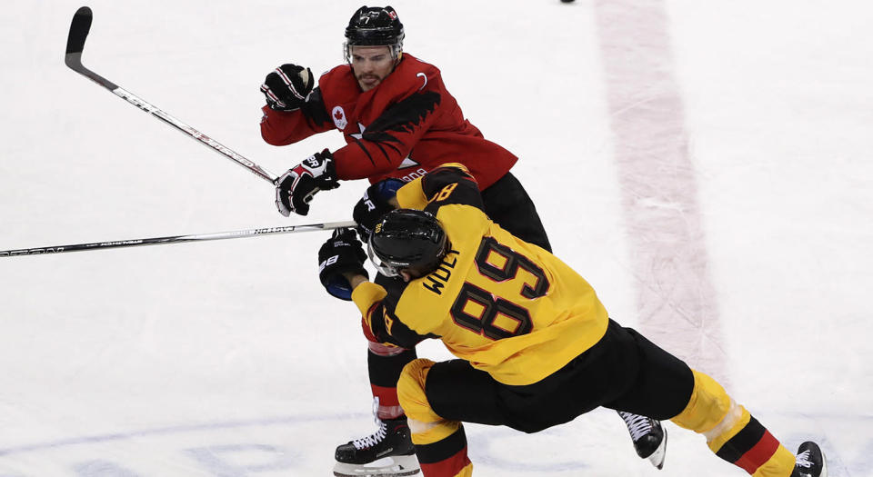 David Wolf of Germany, was taken out by Gilbert Brule on a dirty hit. (Frank Franklin II/AP)