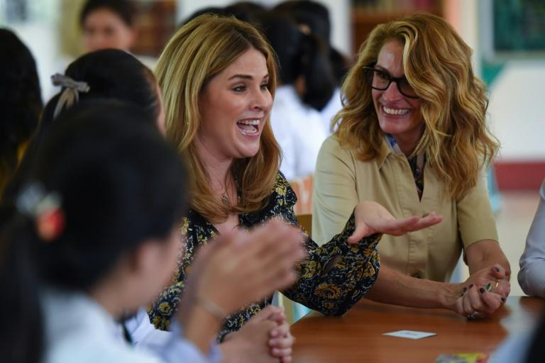Obama was joined in Vietnam by the daughter of former US president George W. Bush, Jenna Bush Hager (left), and actress Julia Roberts (right)
