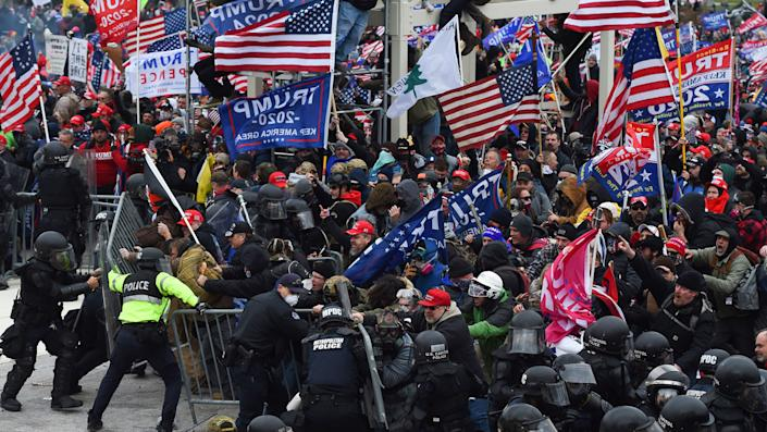 Trump supporters clash with police and security forces as they push barricades