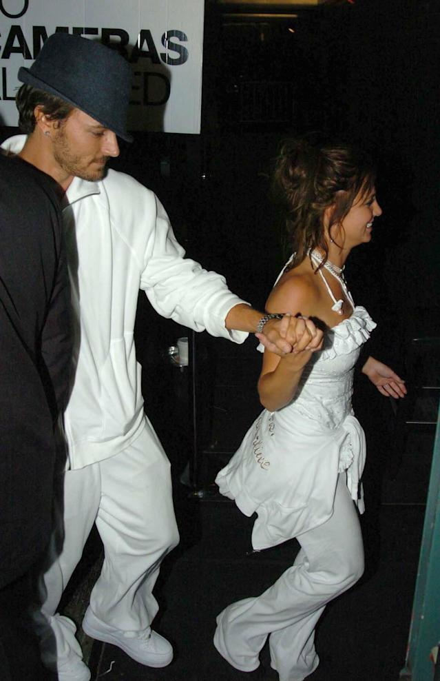 "After their wedding, they went clubbing in matching sweatsuits: ""Mrs. Federline"" for her and ""The Pimp"" for him. (Photo: Splash News)"