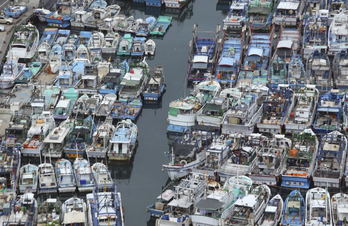 File - In this Aug. 6, 2015, file photo, fishing boats are secured in a port during foul weather in Yilan County, northeastern Taiwan. Taiwan has applied to join an 11-nation Pacific trade group, Cabinet officials said Thursday, Sept. 23, 2021, setting up a potential clash with rival Beijing over the status of the island democracy. (AP Photo/Wally Santana, File)