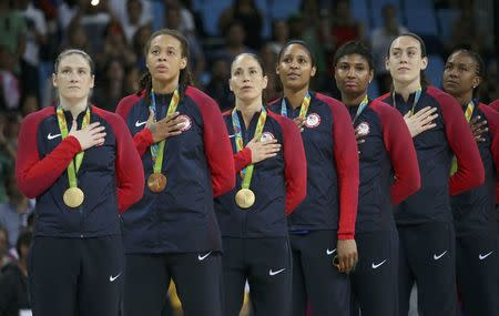 2016 Rio Olympics - Basketball - Final - Women's Gold Medal Game USA v Spain - Carioca Arena 1 - Rio de Janeiro, Brazil - 20/8/2016.  Lindsay Whalen (USA) of USA, Seimone Augustus (USA) of USA, Sue Bird (USA) of USA Maya Moore (USA) of USA, Angel McCoughtry (USA) of USA, Breanna Stewart (USA) of USA and Tamika Catchings (USA) of USA (L to R) stand for the playing of the U.S. National Anthem during the medal presentation ceremony for the women's basketball top finishers.    REUTERS/Shannon Stapleton