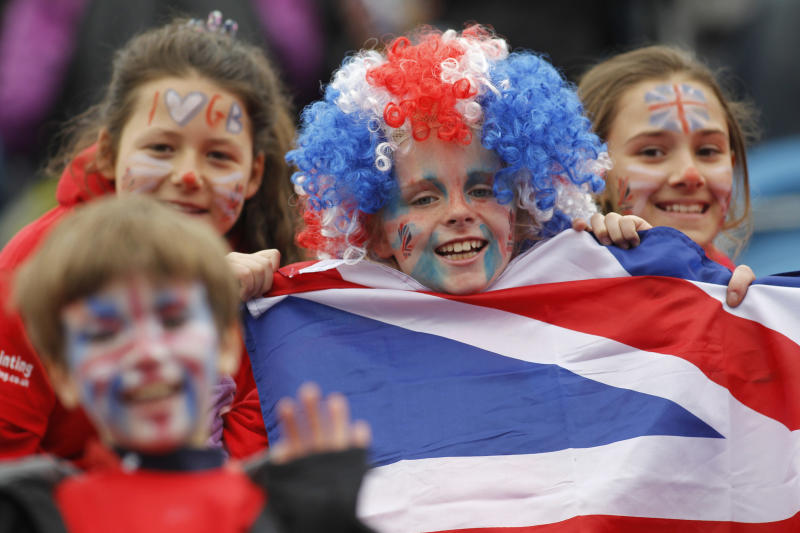 Young spectators show their support in Britain's team during the women's gold medal field hockey match between Britain and Argentina at the Riverbank field hockey arena in the Olympic Park in London, Sunday, May 6, 2012. (AP Photo/Sang Tan)