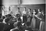 <p>High schoolers practice hitting the right notes during vocal music class.</p>