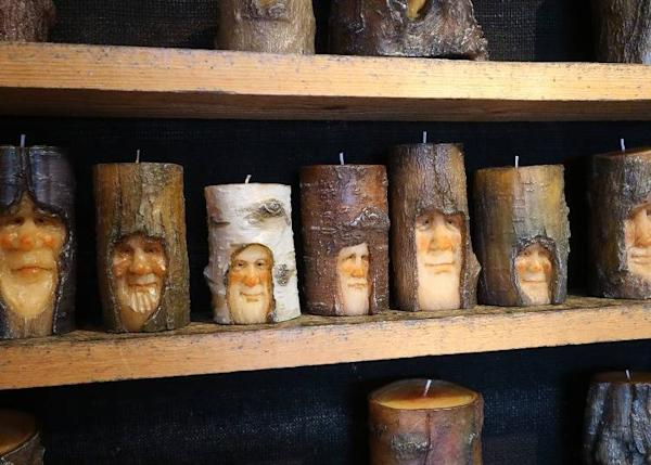 Images of forest sprites that appear to be carved in wood, but which are actually candles