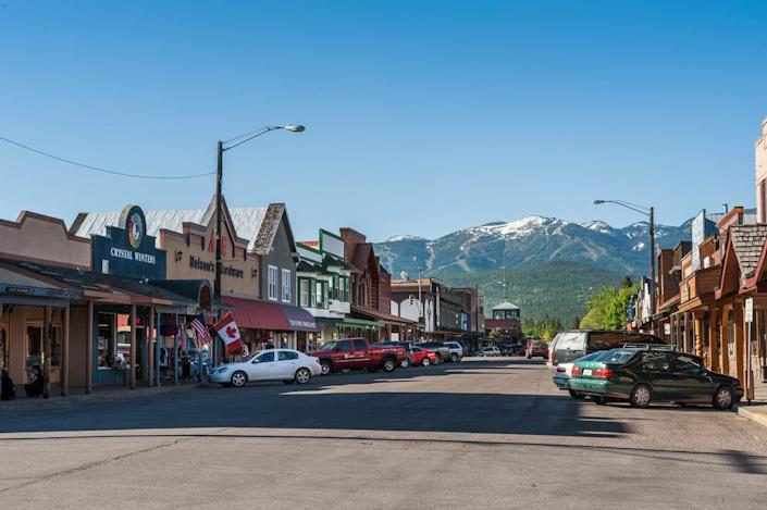 the main street with twons and cars in whitefish montana