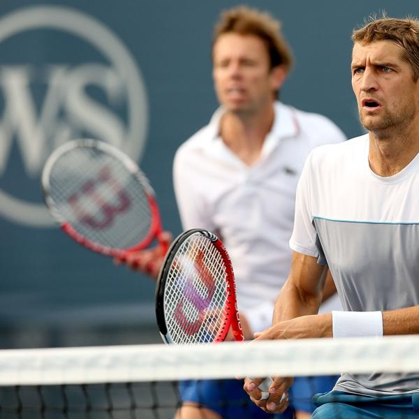 MASON, OH - AUGUST 16:  Daniel Nestor of Canada and Max Mirnyi of Belarus play Andreas Seppi of Italy and Viktor Troicki of Serbia during the Western & Southern Open at the Lindner Family Tennis Center on August 16, 2012 in Mason, Ohio.  (Photo by Matthew Stockman/Getty Images)