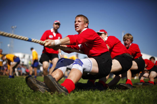 Team Switzerland compete in the 560 kg weight category during the Tug of War World Championships in the town of Appenzell, some 90 km (56 miles) east of Zurich September 8, 2012. The origin of tug of war is in ancient rituals and ceremonies, where the fight between the good and the bad was symbolized and later it developed into a sporting competition. REUTERS/Michael Buholzer (SWITZERLAND - Tags: SPORT SOCIETY)