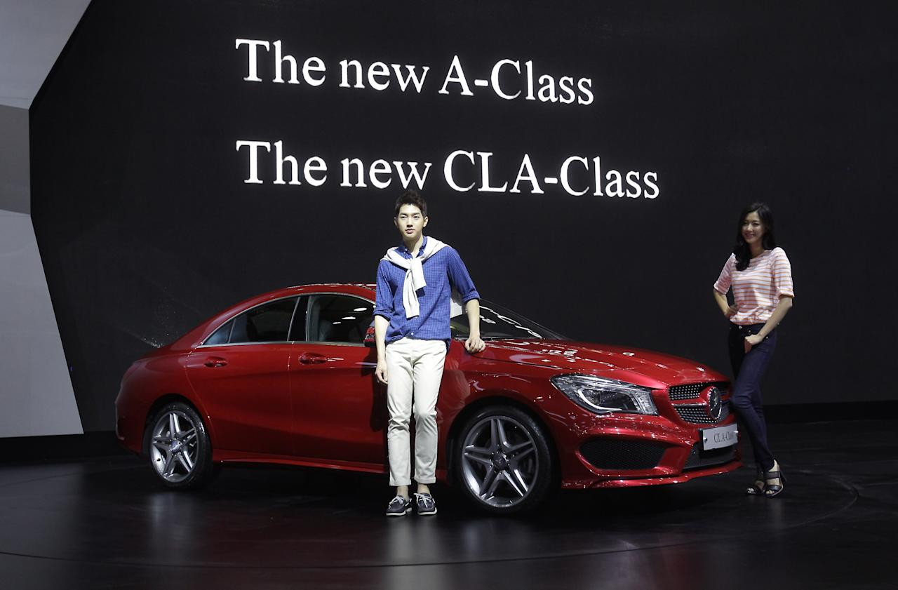GOYANG, SOUTH KOREA - MARCH 28: Models pose next to a Mercedes-Benz New CLA Class at the Seoul Motor Show 2013 on March 28, 2013 in Goyang, South Korea. The Seoul Motor Show 2013 will be held in March 29-April 7, featuring state-of-the-art technologies and concept cars from global automakers. The show is its ninth since the first one was held in 1995. About 384 companies from 14 countries, including auto parts manufacturers and tire makers, will set up booths to showcase trends in their respective industries, and to promote their latest products during the show. (Photo by Chung Sung-Jun/Getty Images)