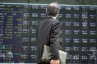 A man looks at an electronic stock board supposedly showing Japan's Nikkei 225 index at a securities firm Thursday, Oct. 1, 2020, in Tokyo. Trading on the Tokyo Stock Exchange was suspended Thursday because of a problem in the system for relaying market information. Most other Asian markets were closed for national holidays. (AP Photo/Eugene Hoshiko)