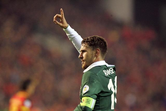 Wales' Aaron Ramsey celebrates after scoring against Belgium during their World Cup Group A qualifying soccer match at the King Baudouin stadium in Brussels, Tuesday, Oct. 15, 2013. (AP Photo/Francois Walschaerts)