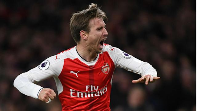 Arsenal kept their Champions League hopes alive as Robert Huth's own goal handed them a 1-0 victory over Leicester City on Wednesday.