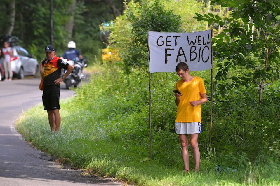 A fan holds a sign with get well wishes for Fabio Jakobsen on stage 2 of the  Tour de Pologne