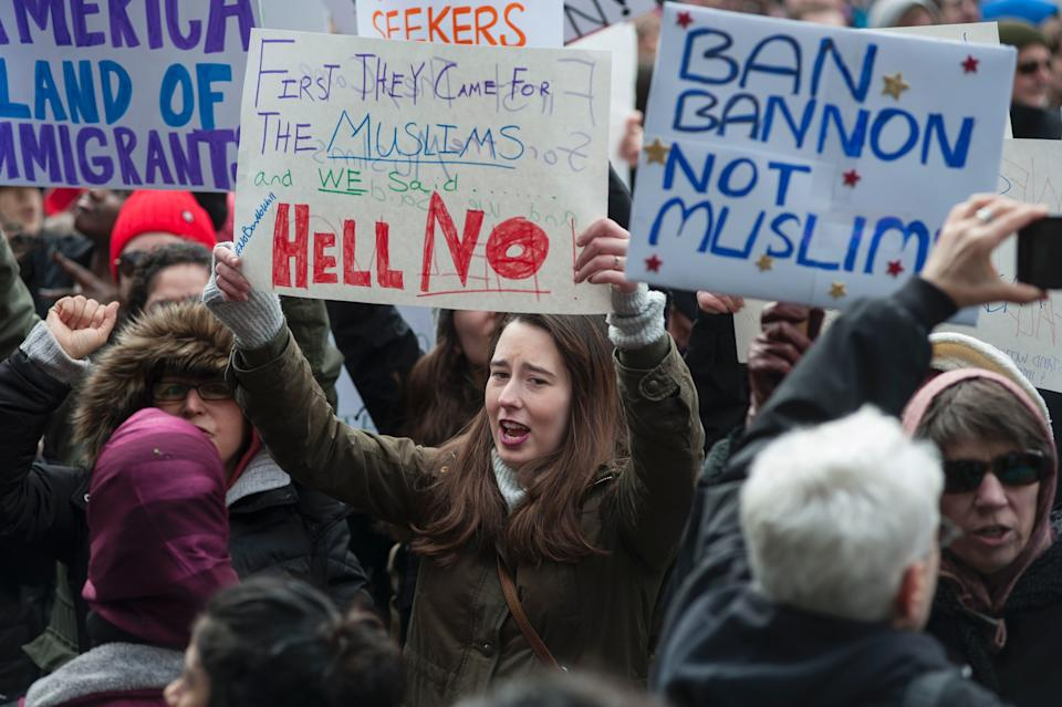 People gather at Copley Square January 29, 2017 in Boston, Massachusetts to decry US President Donald Trump's sweeping executive order.