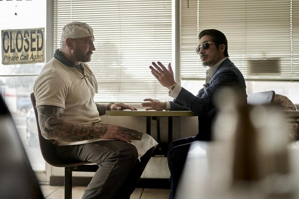 Actors Dave Bautista and Hiroyuki Sanada in a scene from the film.  —  Picture courtesy of Netflix