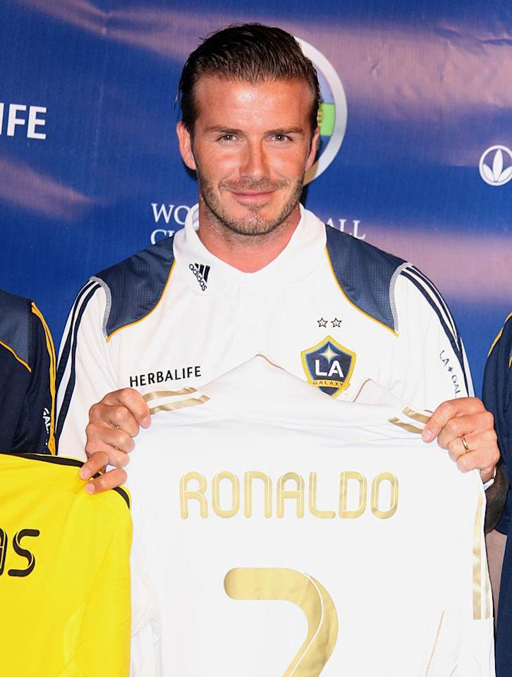 """Let's make this fast, David Beckham has to get home to his new baby! A few days after wife Victoria gave birth to the couple's first daughter, Becks kicked off the Herbalife World Football Challenge 2011 with a press conference in Los Angeles.The hottie held up his old number, Seven, which is also now the middle name of his little girl, Harper. Jen Lowery/<a href=""""http://www.splashnewsonline.com"""" target=""""new"""">Splash News</a> - July 12, 2011"""