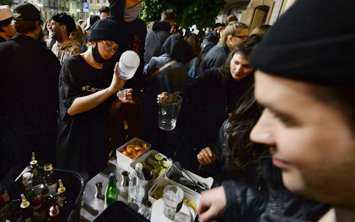 People gather and celebrate as bars, clubs and other establishments reopened in Poland after being closed for seven months, in Warsaw, Poland - Czarek Sokolowski / AP