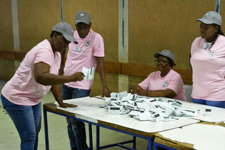 Polling officers verify ballots at a counting centre in the Ledumang Senior Secondary school for the Gaborone North constituency, in Gaborone on October 23, 2019