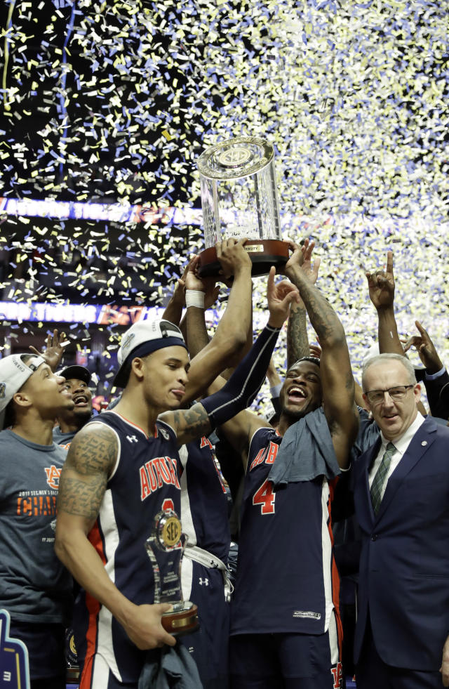 Members Auburn celebrate after defeating Tennessee in the championship game of the NCAA Southeastern Conference basketball tournament Sunday, March 17, 2019, in Nashville, Tenn. Auburn won 84-64. (AP Photo/Mark Humphrey)