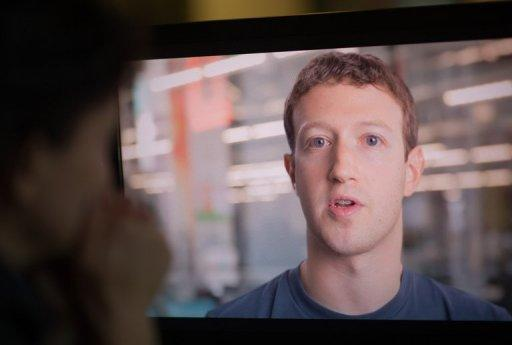 A woman watches Facebook founder and CEO Mark Zuckerberg speaking in a promotional video ahead of the company's IPO, in Washington on May 8. The question of privacy and the use of personal data is a key issue for Facebook as the booming social network prepares to list on Wall Street