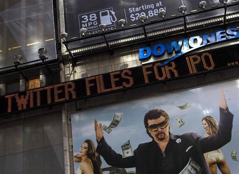 A news ticker in New York's Times Square announces an initial public offering for Twitter Inc.