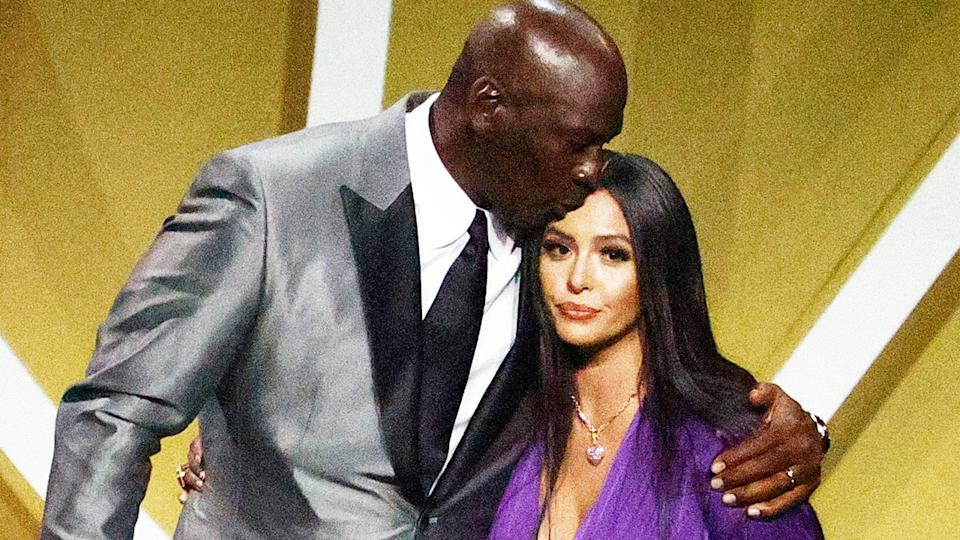 Vanessa Bryant (pictured right) greeted by presenter Michael Jordan (pictured left) on stage.