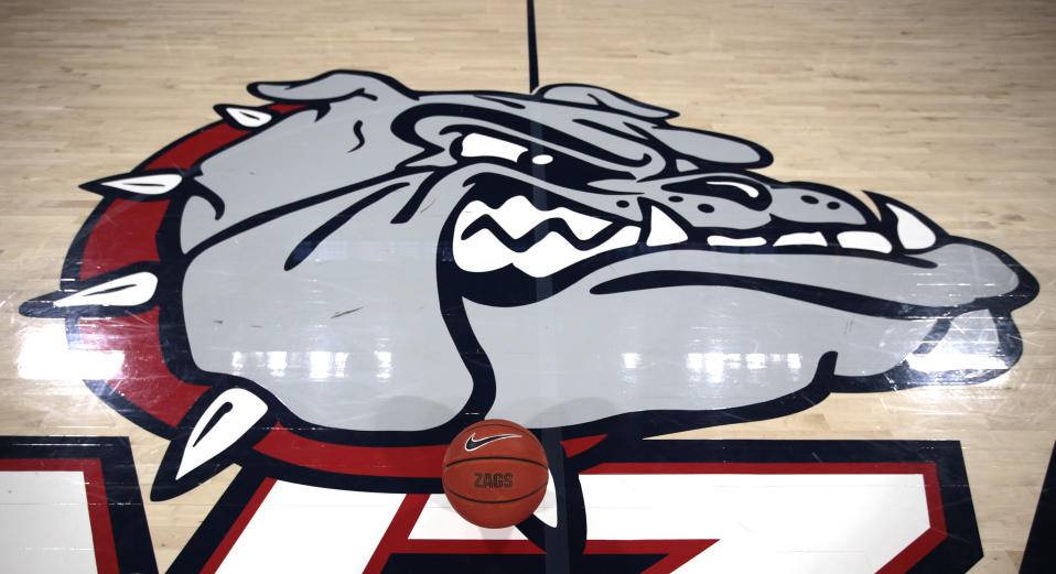 A basketball sits on the court next to the Bulldogs logo prior to the start of a game.