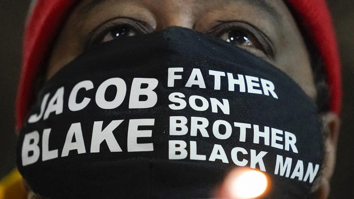 Jacob Blake Sr., father of Jacob Blake, holds a candle at a rally on Jan. 4, 2021, in Kenosha, Wis. (Morry Gash/AP)