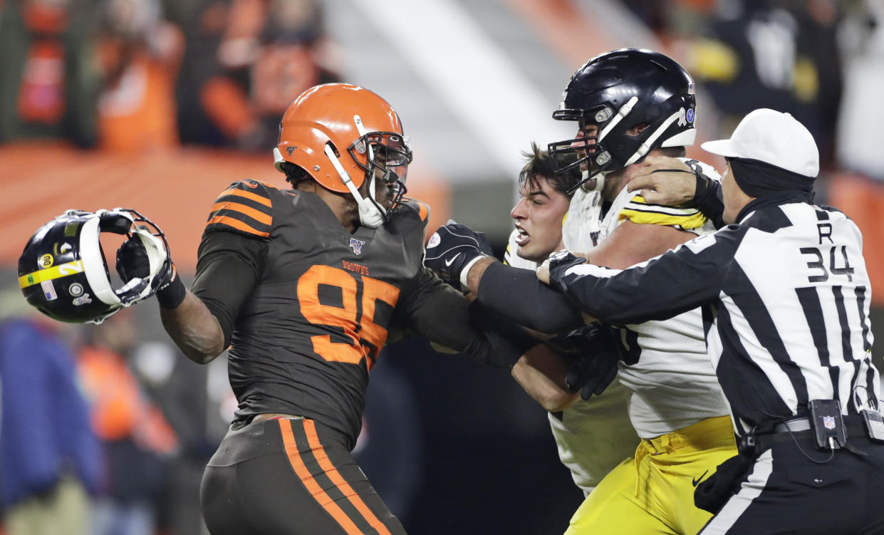 """Cleveland Browns defensive end Myles Garrett, left, called his actions on Thursday night """"selfish."""" (AP/Ron Schwane)"""