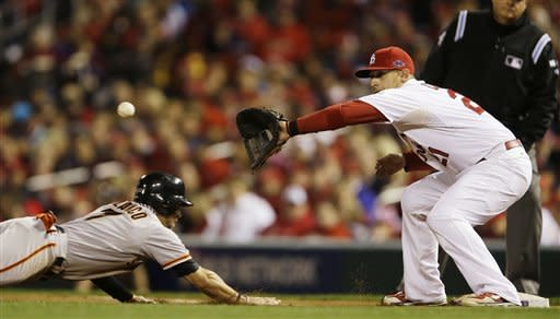 San Francisco Giants' Gregor Blanco makes it back to first as St. Louis Cardinals first baseman Allen Craig takes a throw during the third inning of Game 5 of baseball's National League championship series, Friday, Oct. 19, 2012, in St. Louis. (AP Photo/Jeff Roberson)