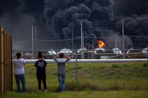 PHOTO: Residents observe the fire consuming the TPC Group plant, Nov. 27, 2019, in Port Neches, Texas. (Marie D. De Jesus/Houston Chronicle via AP)