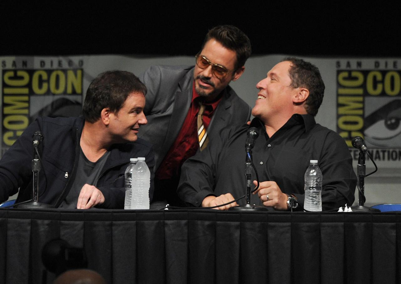 "SAN DIEGO, CA - JULY 14:  (L-R) Director Shane Black, actors Robert Downey Jr., and Jon Favreau speak at Marvel Studios ""Iron Man 3"" panel during Comic-Con International 2012 at San Diego Convention Center on July 14, 2012 in San Diego, California.  (Photo by Kevin Winter/Getty Images)"