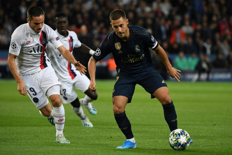 Eden Hazard (R) holds off PSG's Pablo Sarabia - the Belgian made his first start for Real Madrid in Wednesday's game