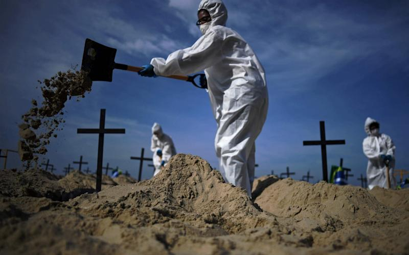 Pandemic graves -  CARL DE SOUZA/AFP via Getty Images