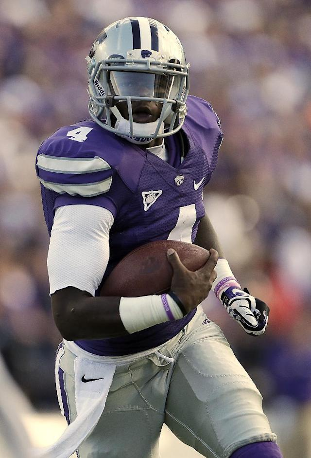 Kansas State quarterback Daniel Sams runs the ball for a touchdown during the first half of an NCAA college football game against TCU, Saturday, Nov. 16, 2013, in Manhattan, Kan. (AP Photo/Charlie Riedel)