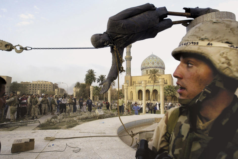 FILE - Iraqi civilians and U.S. soldiers pull down a statue of Saddam Hussein in downtown Baghdad, in this April 9, 2003 file photo. The U.S. invaded Iraq on false claims that Hussein was hiding weapons of mass destruction. (AP Photo/Jerome Delay, File)