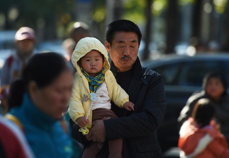 China's one-child policy was supposed to save the country from a looming population explosion, but now it contributes to a greying of society that will exacerbate labour shortages (AFP Photo/Greg Baker)