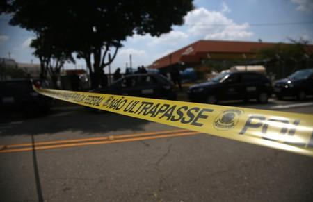The entrance of the Viracopos airport freight terminal is seen blocked after an armed gang robbed a securities company in Campinas