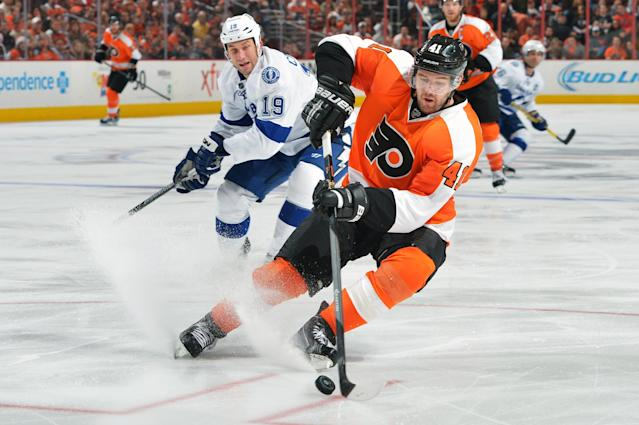PHILADELPHIA, PA - JANUARY 11: Andrej Meszaros #41 of the Philadelphia Flyers pivots away from B.J. Crombeen #19 of the Tampa Bay Lightning at the Wells Fargo Center on January 11, 2014 in Philadelphia, Pennsylvania. The Lightning won 6-3. (Photo by Drew Hallowell/Getty Images)