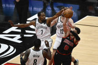 Brooklyn Nets forward Kevin Durant (7) blocks a shot by Chicago Bulls guard Zach LaVine (8) during the second half of an NBA basketball game Tuesday, May 11, 2021, in Chicago. (AP Photo/Matt Marton)
